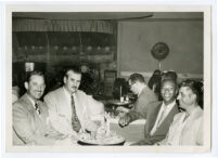 Walter L. Gordon, Jr., and four unidentified men at a nightclub, Los Angeles, 1940s