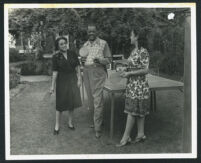 Sydney P. Dones and two unidentified women playing ping pong, Los Angeles, 1940s