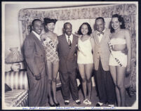 Sam Taylor, Nelson Creswell, and Lionel Hampton with waitresses, Los Angeles, 1940s