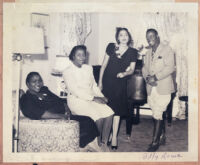 Billy Rowe, of the Pittsburgh Courier, and three unidentified women, Los Angeles, late 1940s or early 1950s