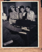 Haven Johnson playing piano for a group of women, Los Angeles, 1940s