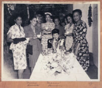 Guest of honor Marva Louis at a party, Los Angeles, 1940s