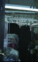 Garment Worker Organizing Clothes