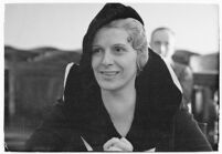 Evangelist Aimee McPherson leaving court after addressing a suit brought against her, Los Angeles, 1935