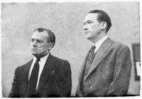 Murder suspect Robert S. James standing next to an unidentified man in court, Los Angeles, 1936
