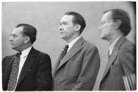 Murder suspect Robert S. James standing between two unidentified men in court, Los Angeles, 1936