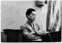 Hal Takaoka, brother of a slain dancer, testifying on the witness stand, Los Angeles, 1936