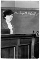 Cafe operator Agnes O'Brien on the witness stand during the liquor license bribe trial, Los Angeles, 1937