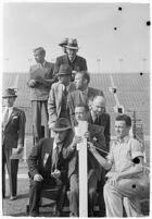 Sports officials keeping time at a track meet between UCLA and USC, Los Angeles, 1937