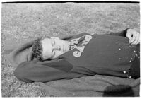 USC track athlete lying on a blanket, Los Angeles, 1937