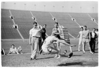 Track athlete in mid-jump during a meet between UCLA and USC, Los Angeles, 1937