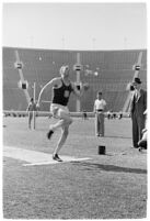 USC track athlete about to jump during a meet, Los Angeles, 1937