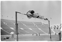 High-jumper completing a jump at a track meet between UCLA and USC, Los Angeles, 1937