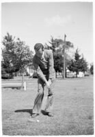 "Golfer Fay Coleman demonstrates a series of ""right"" and ""wrong"" golf swings."