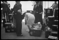 Porters helping passengers of the S.S. Mariposa with their luggage, Los Angeles