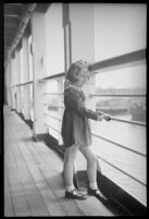 Little girl looking out to the harbor on the S.S. Mariposa, Los Angeles