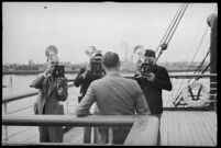 Photographers taking pictures of a passenger on the S.S. Mariposa, Los Angeles
