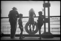 Passengers on the deck of the S.S. Mariposa looking out into the distance, Los Angeles