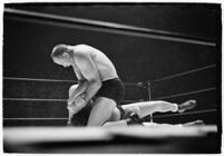 "Wrestlers ""Daniel Boone"" Savage and Hans Steinke battle it out at the Grand Olympic Stadium.  June 16, 1937."