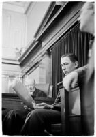 Boy Scout Frank Portune testifies for the court regarding the discovery of the bodies of murdered children Jeanette Stevens and Melba and Madeline Everett.  August 12, 1937.
