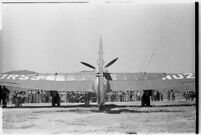 Crowd gathers to catch a glimpse of the airplane that set a world record, flying non-stop from Moscow to southern California.  July 14, 1937.