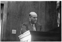 Los Angelest Dist. Attorney's office investigator, Lloyd Yarrow, testifies about the arrest of George K. Thornton, accused of accepting bribes.  July 30, 1937.