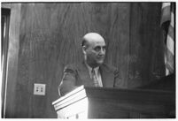 Los Angelest Dist. Attorney's office investigator, Lloyd Yarrow, testifies in court, July 30, 1937
