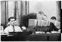 Public defender William Neeley conferring with Ellery Cuff at Albert Dyer's murder trial, Los Angeles, 1937