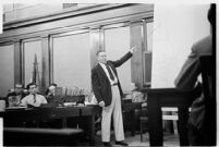 Public defender Ellery Cuff indicating a point on a map at his client Albert Dyer's murder trial, Los Angeles, 1937