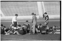 Loyola Lions with their coaches on the Coliseum field, Los Angeles, 1937