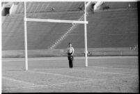 Photographer on the Coliseum field during a game between the Loyola Lions and the Galloping Gaels of St. Mary's, Los Angeles, 1937