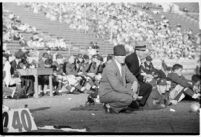 Loyola Lions football coaches watching from the sidelines during a game against the St. Mary's Gaels at the Coliseum, Los Angeles, 1937