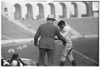 Loyola Lions' head coach Tom Lieb and player, during game against Santa Clara's Broncos, Los Angeles, 1937