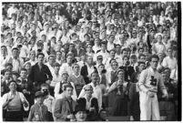 Crowd watches a football match bewteen the Loyola Marymount Lions and the the Santa Clara Broncos, Los Angeles, 1937