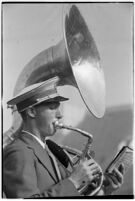 Marching band sousaphone player during the Loyola Marymount Lions football game against the Santa Clara Broncos, Los Angeles, 1937