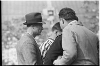 Santa Clara Broncos' head coach Buck Shaw confers with referees during game, Los Angeles, 1937