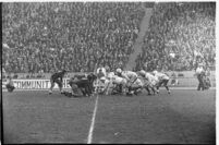 Football teams Santa Clara Broncos and Loyola Lions wait for the snap, Los Angeles, 1937