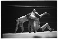 Heavyweight wrestler Vincent López grappling with newcomer El Pulpo at the Olympic, Los Angeles, 1937