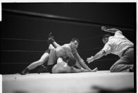 Heavyweight champion Dean Detton wrestling an opponent at the Olympic, Los Angeles, 1937