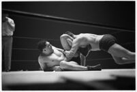 Heavyweight champion Dean Detton wrestling an opponent at the Olympic Auditorium, Los Angeles, 1937