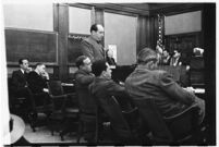 Defense attorney Jerry Giesler in court during the trial of accused murderer Paul A. Wright, Los Angeles, 1938.