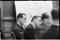 Accused murderer Paul A. Wright sitting with his attorneys in court, Los Angeles, 1938