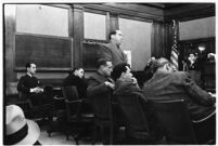"Defense attorney Jerry Giesler in court during the trial of accused murderer Paul A. Wright, Los Angeles, 1938. nt Los Angeles defense attorney Jerry Giesler, photographed in court during the ""white flame"" double homicide trial.  Los Angeles, 1938."