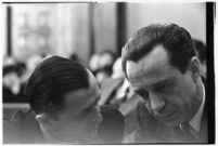 Accused murderer Paul A. Wright conferring with an attorney in court, Los Angeles, 1938.
