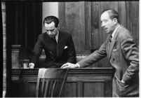 Accused murderer Paul A. Wright being questioned in court, Los Angeles, 1938