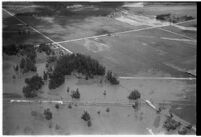 Aerial view of flooded crops and homes in North Hollywood, Los Angeles, 1938