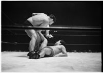 Heavyweight wrestler El Pulpo grappling with an opponent at the Olympic Auditorium, Los Angeles, 1937