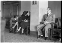 Private detective Pearl Antibus appears in court with her daughter Norma Thelan and son Robert Antibus during her trial against millionaire Thomas W. Warner, Sr, Los Angeles, 1938