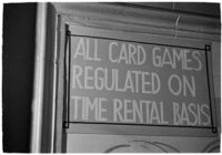 Sign detailing policies hanging inside of a casino, Los Angeles, 1937
