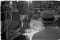 Patrons playing cards in a casino, Los Angeles, 1937